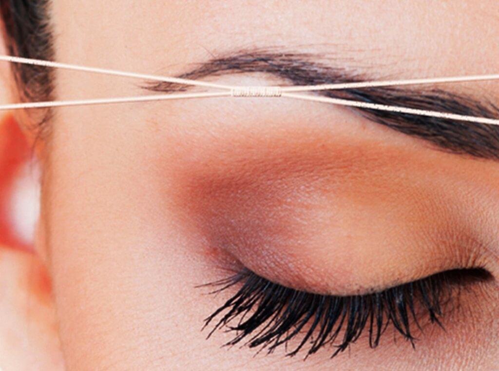 как ниткой удалять волосы на лице